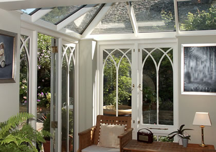 Conservatory with gothic arch style windows in Cotswolds