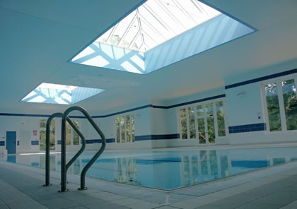 Pool cover over large pool in private school in Surrey
